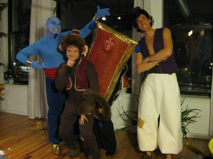Aladdin group costume with Aladdin, Genie, flying carpet and Abu.