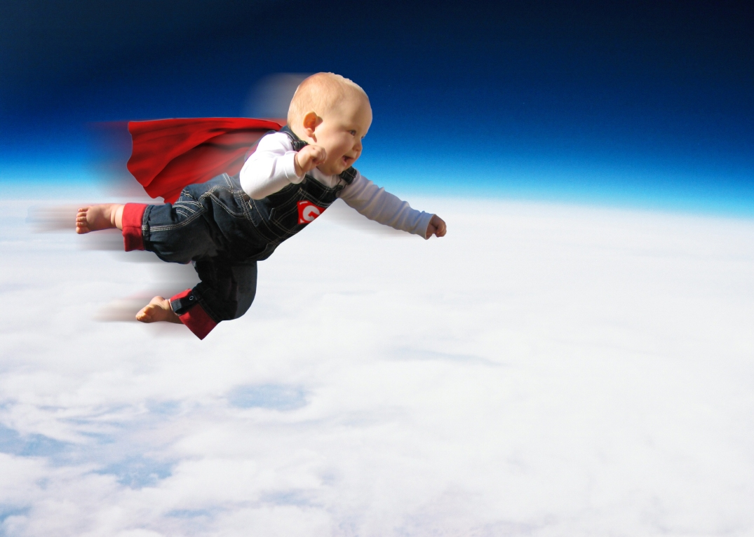 Photoshopped image of superhero toddler