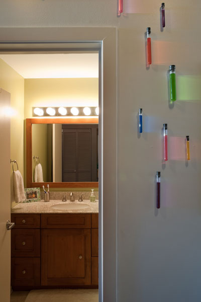 Test tubes with colored liquid decorate a wall