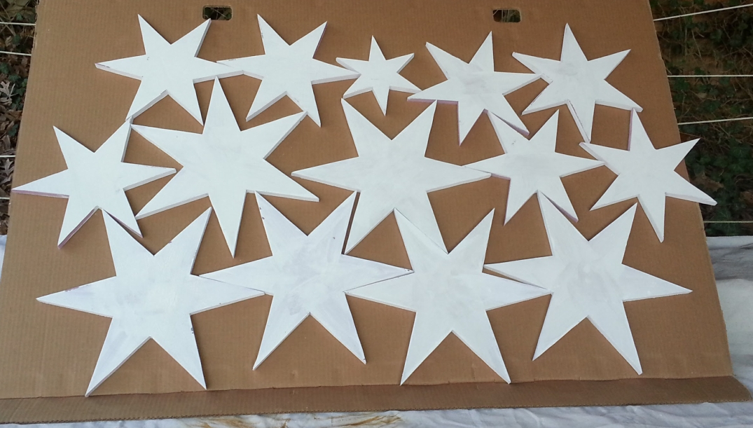 foam stars painted white before painting with metallics