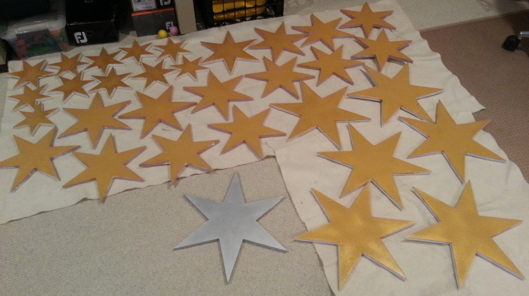 Gold foam stars drying between coats of paint.