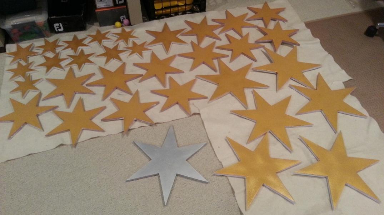 Gold foam stars drying between coats of paint.