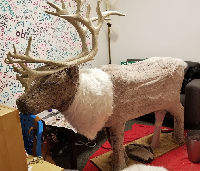 """I used a brown faux fur with light brown tips to cover the body, legs and head. The collar and tail were a longhair off-white fabric. The fur on the face and """"hooves"""" were trimmed to appear darker."""