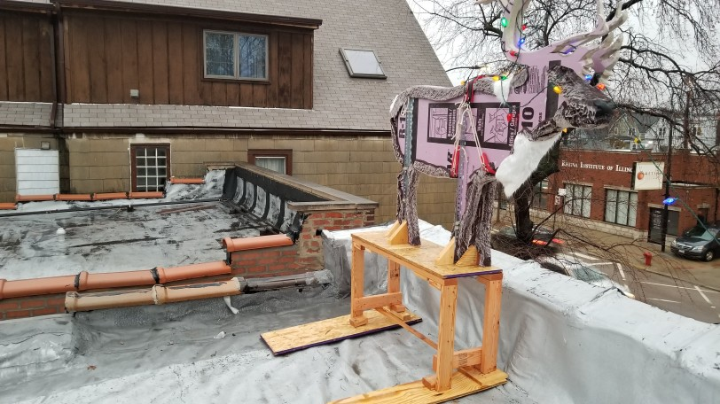 The base elevates the reindeer to the height of the parapet wall.